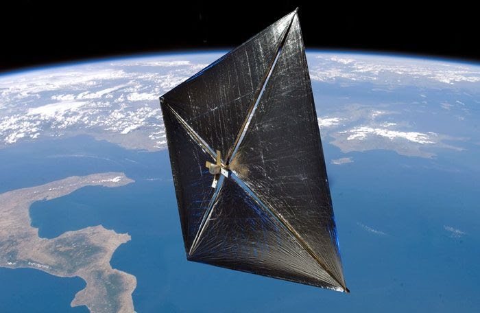 A composite photo of the NanoSail-D spacecraft in low Earth orbit.