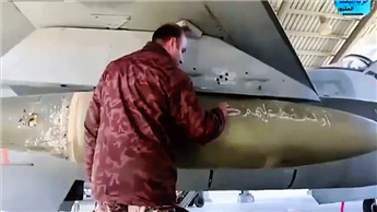 A Jordanian air force pilot writes a message to the Islamic State on a missile at Mowafak Al-Salti airbase in Azraq, Jordan, on Friday.  AP