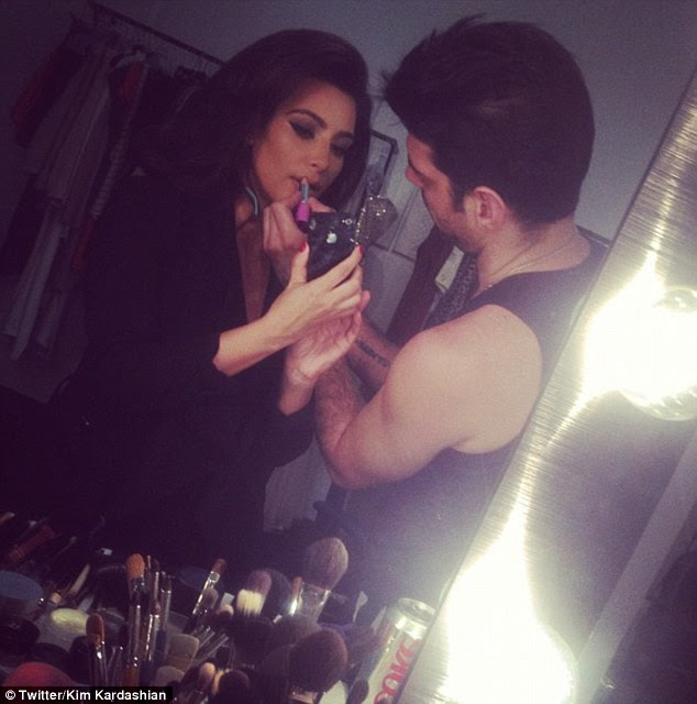 Tended to: Kim was seen getting her make-up touched up by a stylist
