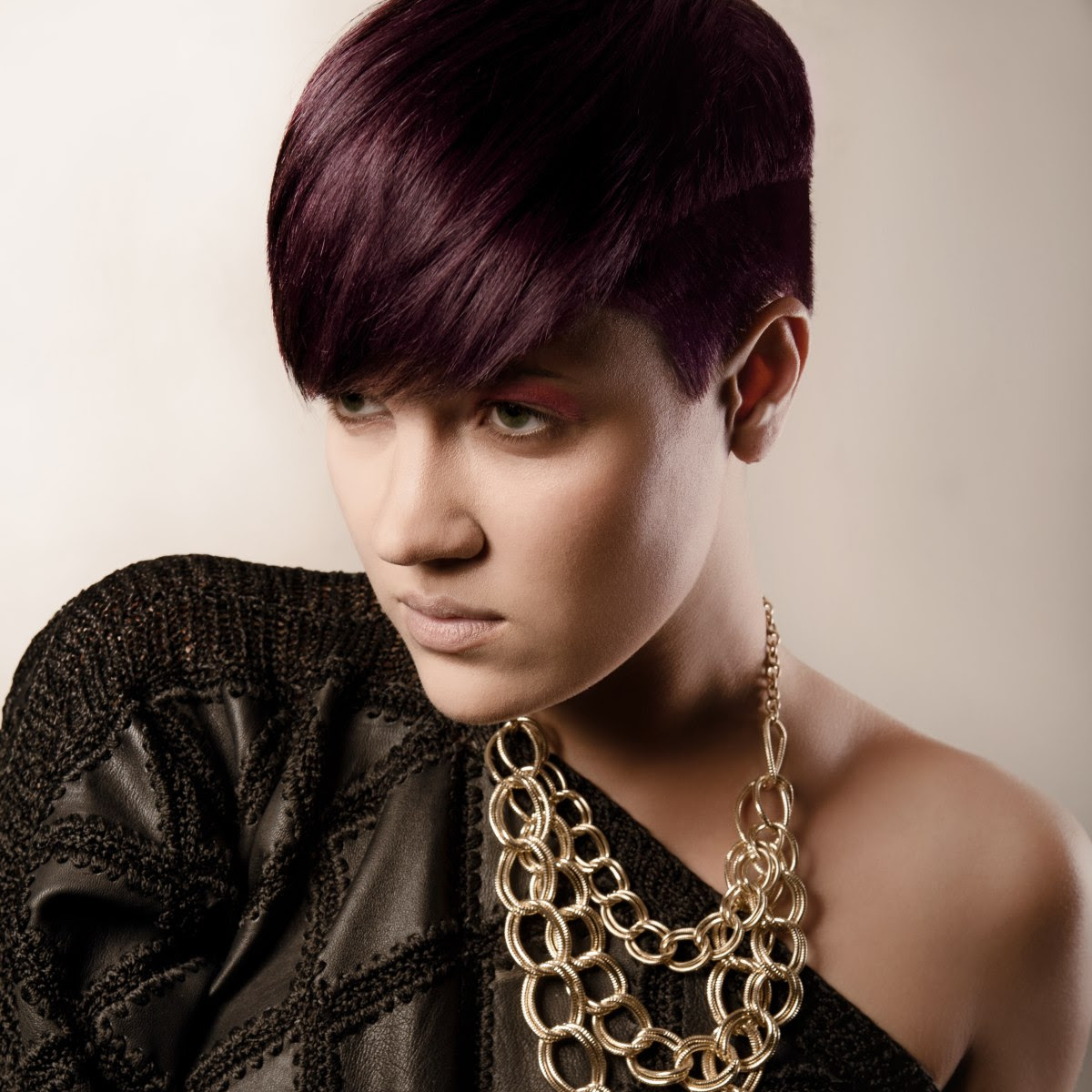 Purple hair with the sides and back cut ultra short