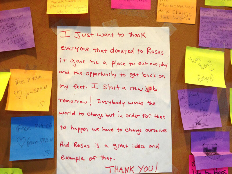 Messages adorn the walls of a Philadelphia pizza shop where customers pay an extra $1 to feed a person who is homeless.