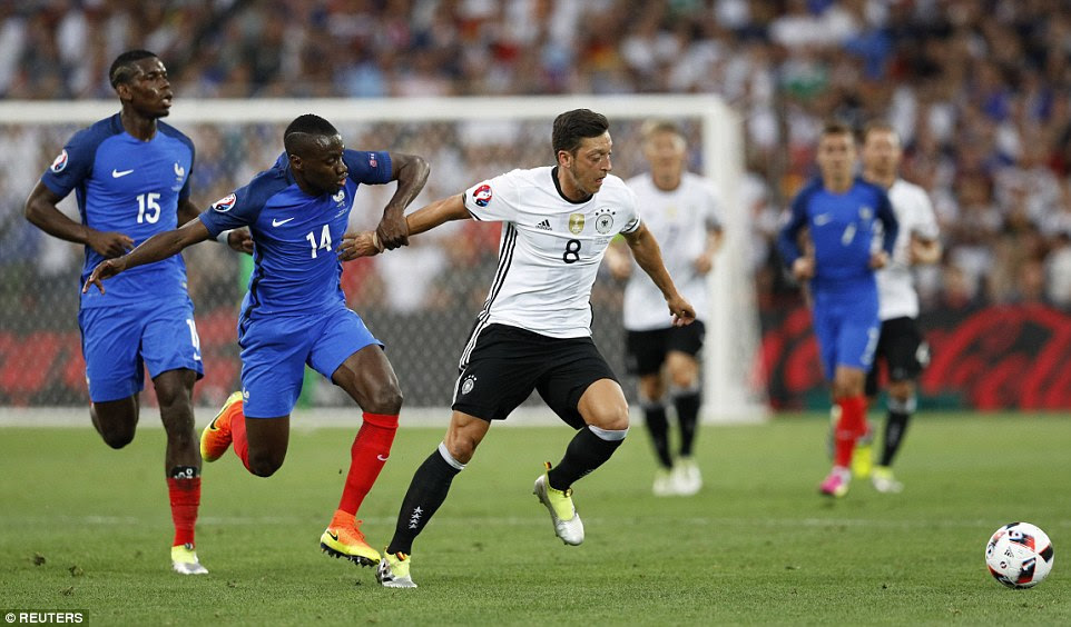 Meust Ozil holds off the attentions of Pogba and Matuidi as Germany took control of the tie, rattling the French
