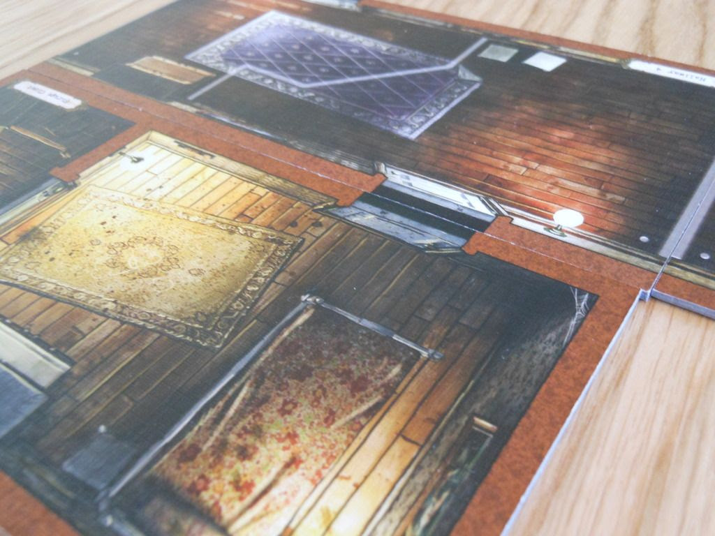 Close up view of Mansions of Madness board sections, which link together in different configurations to make spooky, unnatural buildings to explore.
