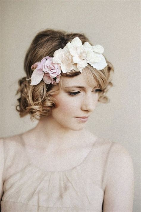 short with curls, side swept bangs and large floral head