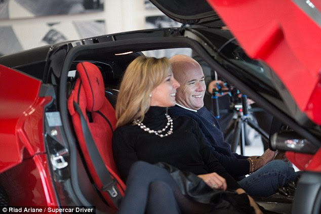 Life of luxury: Paul Bailey, 55, and 49-year-old wife Selena, pictured in their new LaFerrari, made £28million when they sold their telecommunications business in 2012