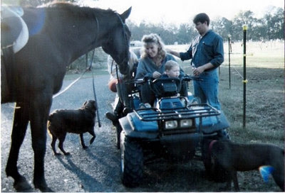 Candy and Fred (horse) visiting with friends on 4 wheeler.