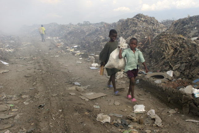 Members of the Chilean and Brazilian contingents of the United Nations Stabilization Mission in Haiti (MINUSTAH) conduct rehabilitation works and CIMIC (Civil-Military Cooperation) activities in Haiti. Many corners of Port-au-Prince are covered with mountains of garbage. Children carry plastics and metals for recycling scrounged from the smoldering garbage dump of Port-au-Prince through this road that is muddy and dusty. The construction of the new road is one of the CIMIC projects.
