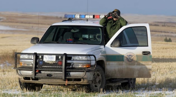 A border patrol agent monitors the Canada-U.S. border in Montana, which has 550 miles of largely unprotected border.