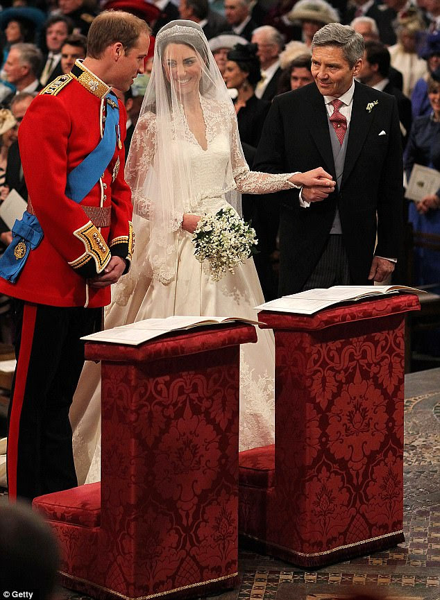 'You look beautiful': Prince William speaks to his bride Kate as she holds her father's hand at the altar