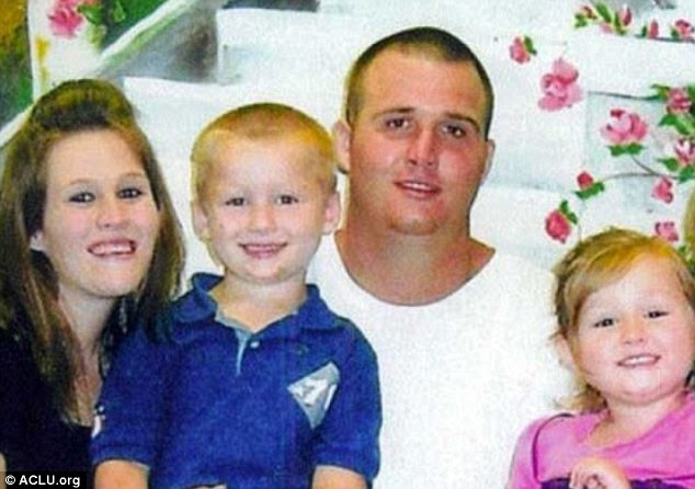 Patrick Matthews with his family, pictured with his young children Blayton and Hayley, was jailed for life in 2009 in Louisiana for stealing a power-tool. Matthews, now 25, is serving a life term for his crime
