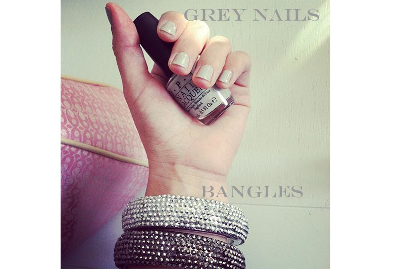 Grey nails and big bangles.psd