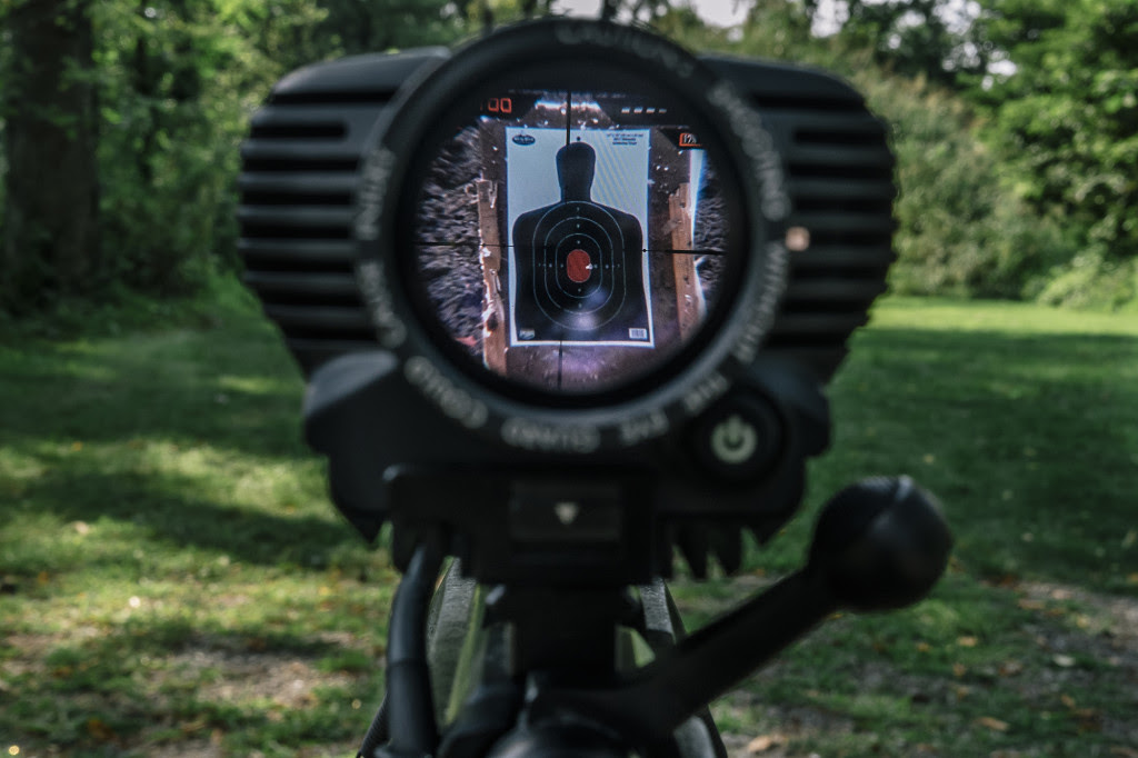 A view through the scope of the Tracking Point TP750 shows the white dot which can be set so the rifle doesn't fire until it is in the crosshairs again.