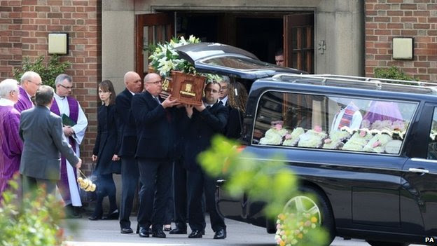 Ann Maguire's coffin is placed into hearse