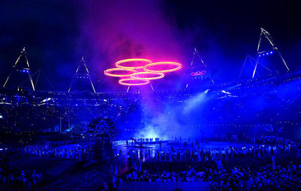 The Olympic rings glow above the stadium in a scene depicting the Industrial Revolution during the opening ceremony of the London 2012 Olympic Games on Friday.