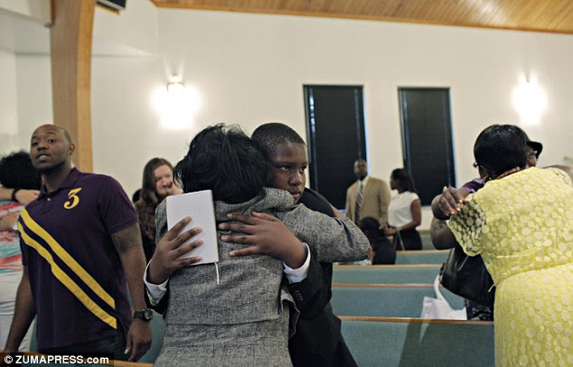Looking for a family: 15-year-old Davion spoke to the church congregation about how badly he wanted a family to care about him