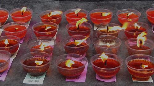 Votive candles, Qile temple, Nanchong