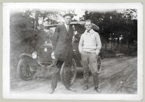 Two men and automobile