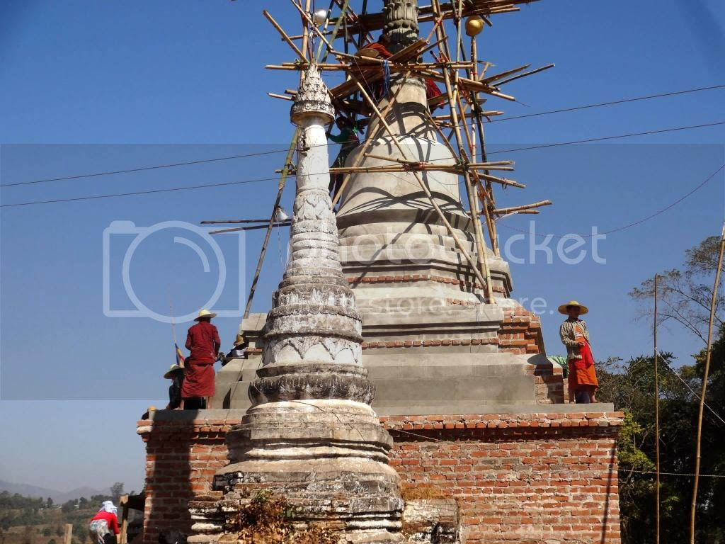 Repairing the village stupa photo 894958_10152271915401202_1145456222_o.jpg