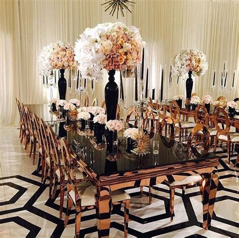 Inspiration for a modern black, white and copper reception