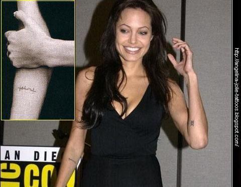 "Angelina Jolie tattoos. Arabic phrase ""العزيمة"" (strength of will) This is"