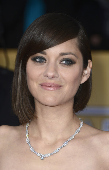 Actress Marion Cotillard arrives at the 19th Annual Screen Actors Guild Awards held at The Shrine Auditorium on January 27, 2013 in Los Angeles, California.