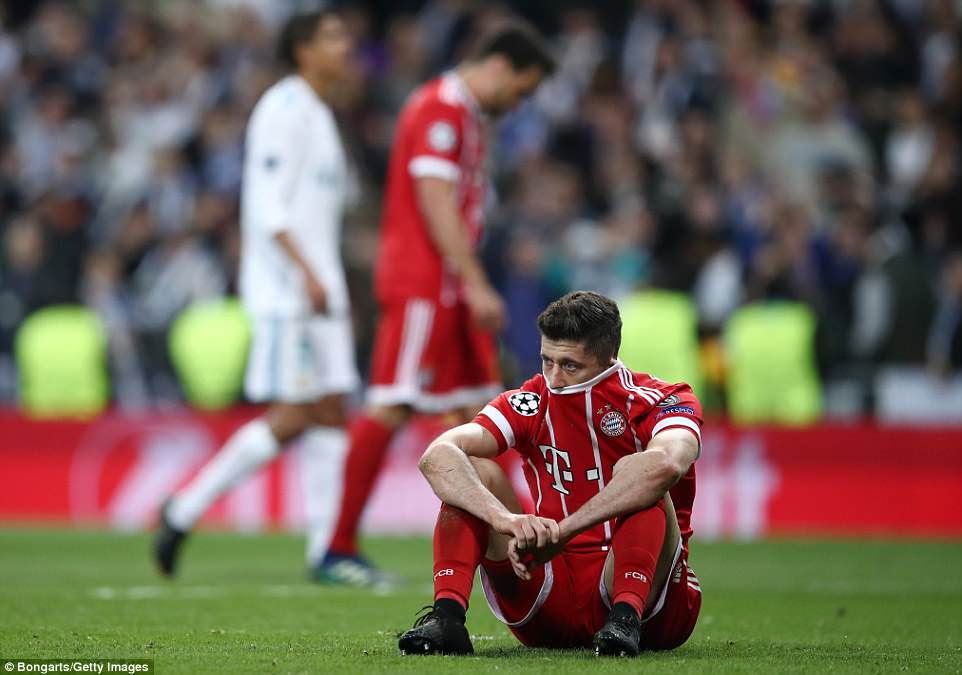Bayern Munich striker Lewandowski struggles to hold back the tears as they crash out of the Champions League semi-finals