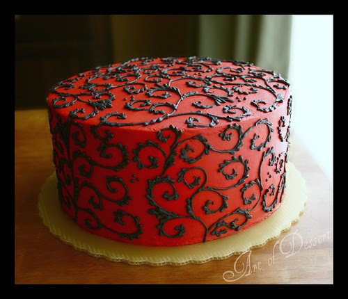 Red Cake with Black Scrolls