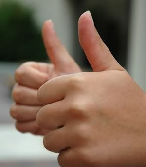 two thumbs up Pictures, Images and Photos
