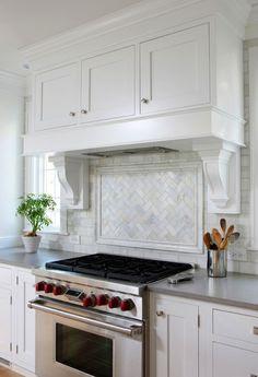 Normandy Remodeling - kitchens - Benjamin Moore - Paper White - wood panel kitchen hood, white corbels, herringbone tiles, herrinbone backsp...