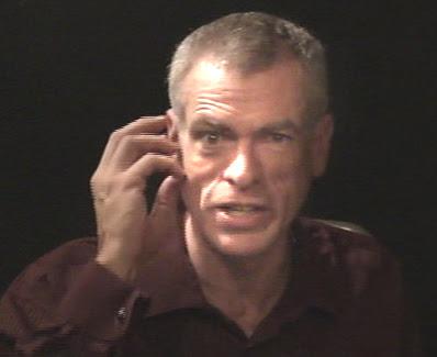 Steve Schalchlin cups ear
