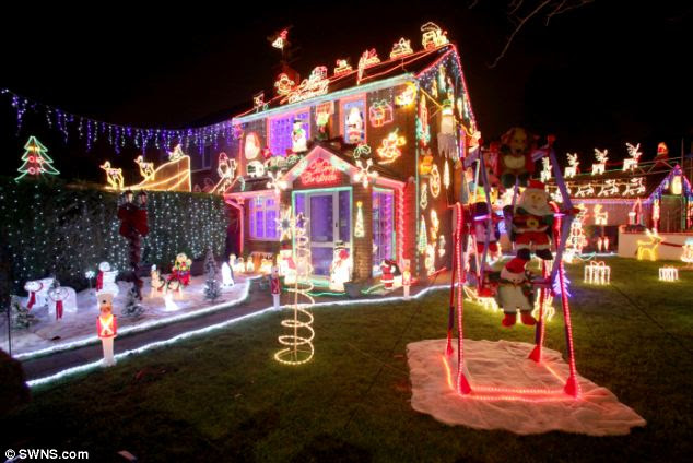 Festive: Two Bristol brothers last night turned on the lights at their mother's home to start the festive season