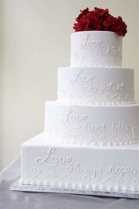 This wedding cake features a Corinthians verse written on