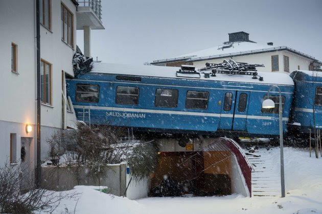 A local train that derailed and crashed into a residential building in Saltsjobaden is seen outside Stockholm in this picture taken by Scanpix Sweden January 15, 2013. According to local media, a spokesman from Arriva, the company that operates the train line, says the train was stolen by a domestic cleaner,  who stole the train for unknown reasons. The cleaner was taken to a hospital after the crash. No residents in the building were injured.  REUTERS/Jonas Ekstromer/Scanpix Sweden (SWEDEN - Tags: SOCIETY TRANSPORT)   ATTENTION EDITORS - FOR EDITORIAL USE ONLY. NOT FOR SALE FOR MARKETING OR ADVERTISING CAMPAIGNS. THIS IMAGE HAS BEEN SUPPLIED BY A THIRD PARTY. IT IS DISTRIBUTED, EXACTLY AS RECEIVED BY REUTERS, AS A SERVICE TO CLIENTS. SWEDEN OUT. NO COMMERCIAL OR EDITORIAL SALES IN SWEDEN
