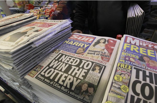 Copies of The Sun newspaper are seen for sale at a newsstand in London