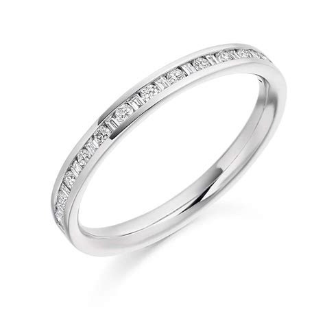 Platinum 0.3ct Round Brilliant Cut and Baguette Cut
