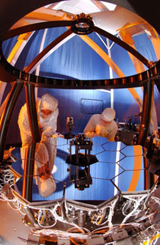Engineers at Ball Aerospace test the Wavefront Sensing and Control  testbed to ensure that the 18 primary mirror segments and one secondary  mirror on JWST work as one
