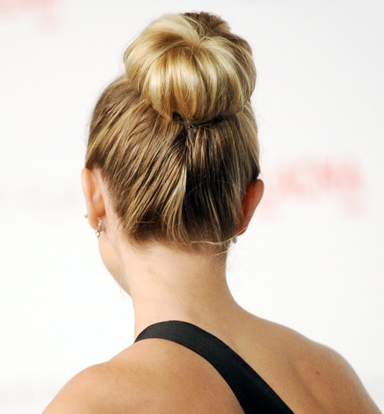 Even leading ladies are embracing the neat and tidy sock bun, which can easily be done with a cut sock, an elastic and a few bobby pins. (Pictured: Reese Witherspoon)