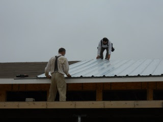 Placing the Roof Metal on the Roof