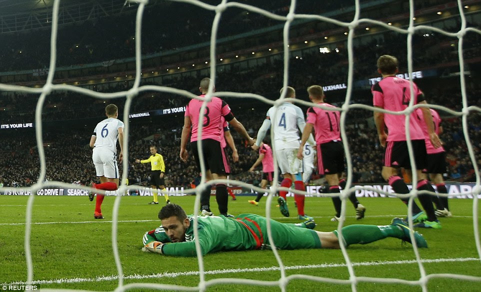 Gordon looks back in despair after conceding for a third time, with Cahill's goal preventing any way back for the Scots