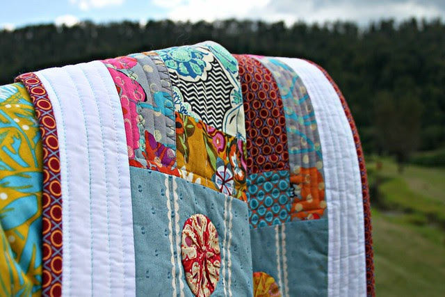 Applique Art Quilt -- Details. White Border stitched with Variegated Aqua Aurifil