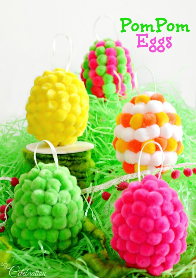 Turn plastic Easter eggs into bright & whimsical PomPom Egg with ready-made pompoms & hot glue!  Hang as decoration or use for an indoor egg hunt! At littlemisscelebration.com