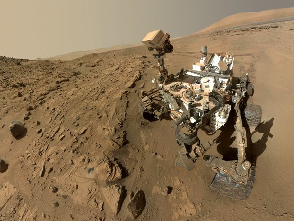 A self-portrait of NASA's Curiosity Mars rover, taken with a camera on her robotic arm in late April and early May of 2014.