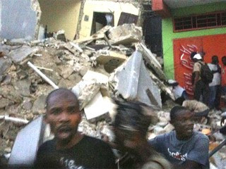 PHOTO A strong earthquake hit Haiti on Tuesday, Jan. 12, 2010 where a hospital collapsed and people were screaming for help. Other buildings also were damaged.