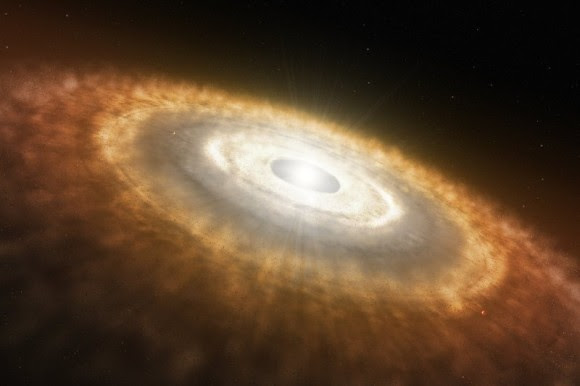 Artist's impression of a baby star still surrounded by a protoplanetary disc in which planets are forming. Credit: ESO