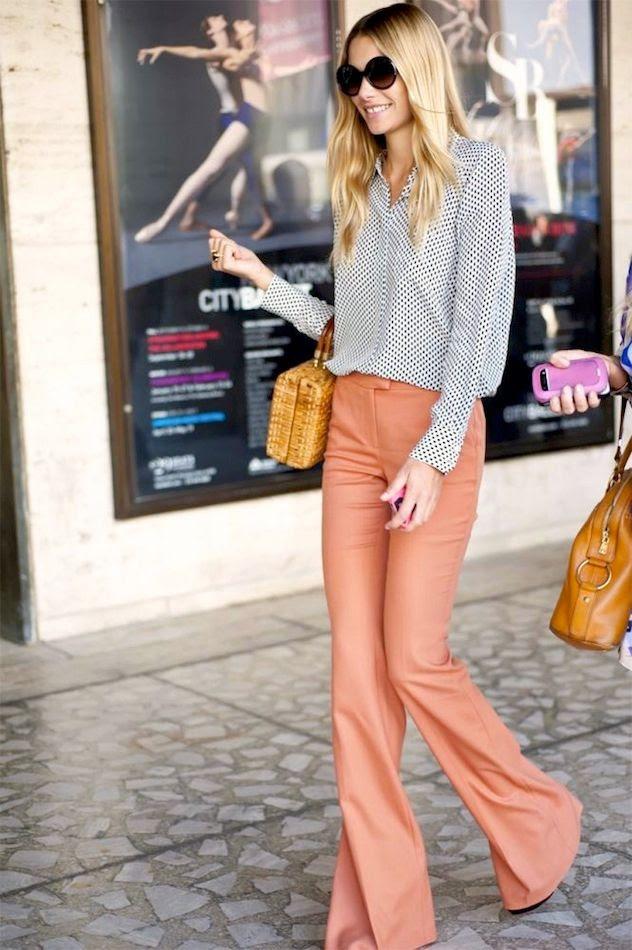 Le Fashion Blog New York Fashion Week Street Style Jessica Hart Print Shirt Straw Bag Peach Flares Orange Flared Pants Via HuffPo