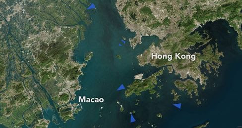 The blue triangles mark the location of Very Large Crude Carriers around the port of Hong Kong.