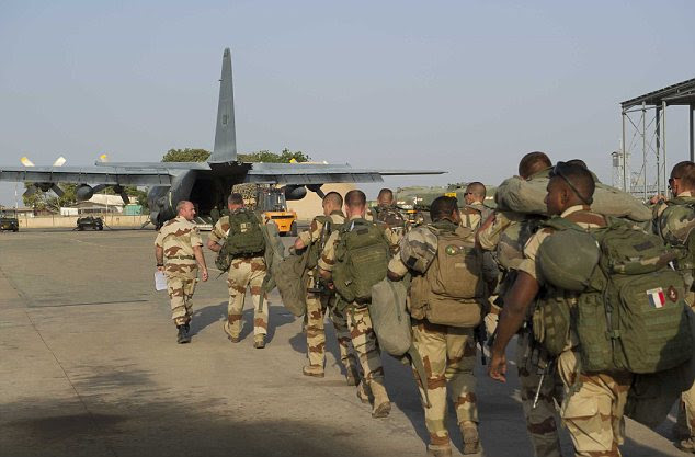 Deployed: French soldiers of the 21st Marine Infantry Regiment boarding to Bamako, the capital of Mali, at the N'Djamena's airport in Chad.