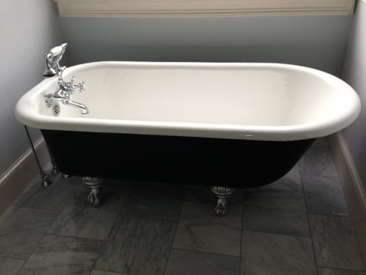 Turn of the century rescued clawfoot tub installed in place of
