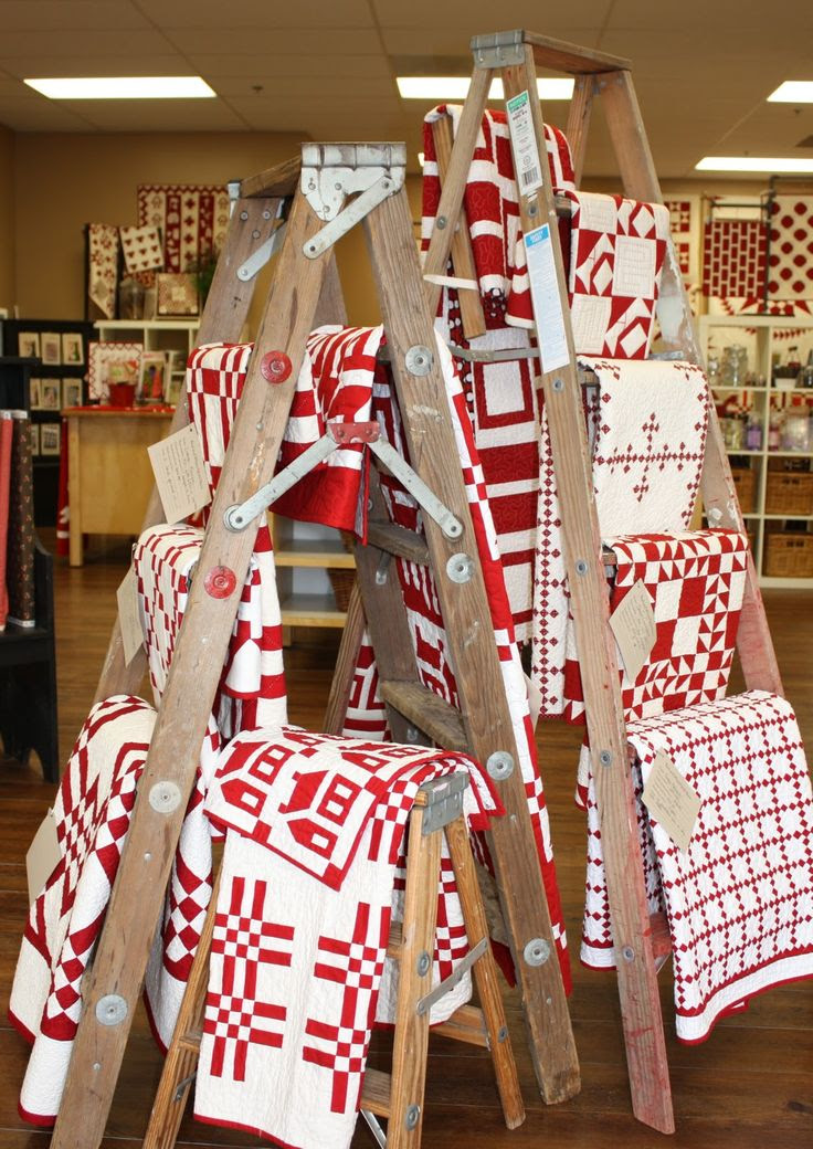 Repurpose ladders to display blankets. #retail #display #merchandising #repurpose