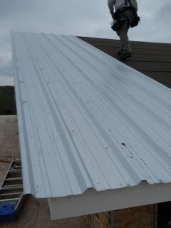 First Piece of Roofing Metal Installed